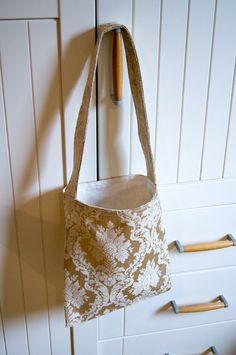 Finished gold brocade shoulder bag