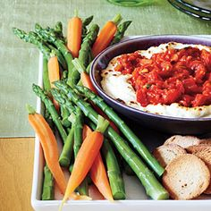 Baked Goat Cheese Dip - Bake a mixture of goat cheese and cream cheese and top with a spicy tomato mixture for a warm dip that's great for entertaining. FREEZE AHEAD - You can assemble this dip ahead and freeze for up to 1 month. Best Party Appetizers, Cheese Appetizers, Snacks Für Party, Easy Appetizer Recipes, Dip Recipes, Cooking Recipes, Game Recipes, Appetizer Ideas, Simple Appetizers