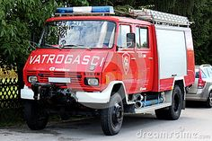 Older basic firetruck number 231 in complete driving condition with full equipment, cleaned and ready for action.