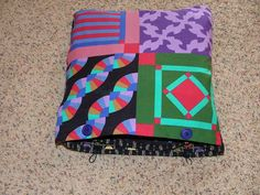 Quillow :  Etymological Note: quilt + pillow   Why make a quillow and not just a quilt?  With high school or college graduations qui...