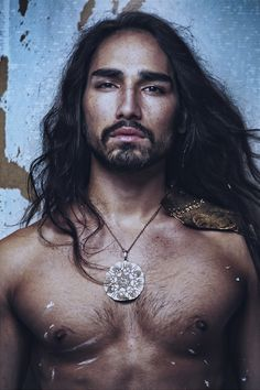 Willy Cartier is photographed in Paris with orginal artwork by painter Jack Servoz.  Photography by Franck Glenisson.