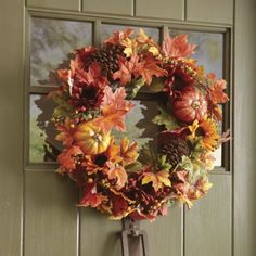 Bountiful, Beautiful Wreath Think of your front door as an empty frame to place a gorgeous display of harvest-hued flowers. Choose a decorative #wreath filled with sunflowers, #fall leaves and mini gourds.