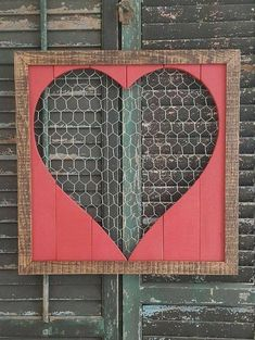 This heart shaped home decor would look wonderful in your home! Measuring 16x16, this features a chicken wire(new) background, painted Valentines Day Red, and a border stained with English Chestnut Minwax Stain. This can come stained with any of Minwaxs stains, if nothing is noted,