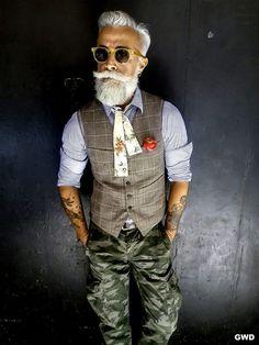 Shop this look on Lookastic: https://lookastic.com/men/looks/waistcoat-long-sleeve-shirt-cargo-pants-bow-tie-belt-sunglasses/12630 — Tan Sunglasses — Beige Floral Bow-tie — Blue Chambray Long Sleeve Shirt — Grey Leather Belt — Olive Camouflage Cargo Pants — Grey Plaid Waistcoat