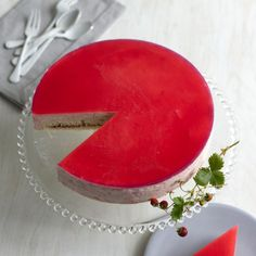 A yellow cake gets filled with jam then cleverly surrounded by a rhubarb mousse by using a larger spring-form pan as a mold. A jewel-like rhubarb glaze creates a finishing touch. If you have small, early tri-star or wild strawberries to garnish the top, so much the better!