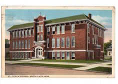 Vintage 1910s postcard showing St. Patrick's School at North Platte, Nebraska. Published by C. T. American Art. Card number 4-68541. Card is used with North Platte postmark. Mailed to Miss Minnie Gerb