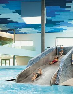 colorful mosaic wall pattern and awesome indoor pool I want tht for my kids