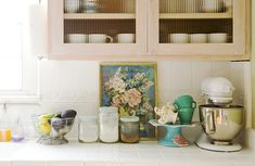 sweet kitchen styling | raya carlisle. add a simple art print to your kitchen counter to add immediate style.