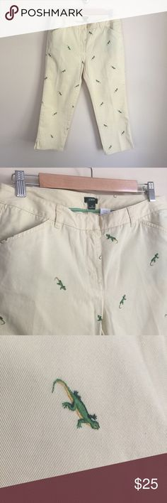 "NWT J. Crew Favorite Fit lizard cropped pants 8P NWT J. Crew Favorite Fit lizard cropped khakis, size 8P.   Buttercream color (very pale cream-yellow) with green embroidered lizards, mid-rise, relaxed fit, rear pockets have hidden button closure.   Condition: New with tags (NWT).   Material:  100% cotton.   Measurements (approximate, taken laying flat):  length 32.5"", inseam 23.5"", rise 9.5"", flat waistband 16"", flat hip 19"". J. Crew Pants Ankle & Cropped"