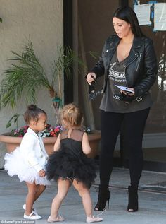 Kim's in charge: The reality star appeared to have the little ones under control...