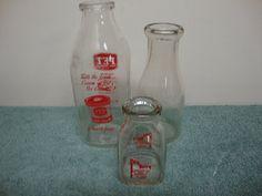 Three Vintage Glass Milk Bottles