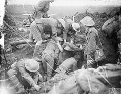 WWI, 20 Sept 1917; Battle of the Menin Road Ridge. Troops of the 13th Battalion, Durham Light Infantry digging out wounded from their Regimental Aid Post near Zillebeke after the position had be hit by German artillery fire. © IWM (Q 5979)