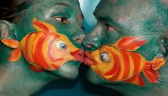 2. Two fish kissing and an elephant painted on a hand