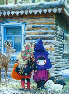 """Traditional wooden house """"Izbushka"""" and two little girls, Russia"""