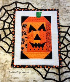 Log cabin Halloween wall hanging by Quilted Cupcake