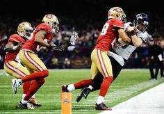 Kicker Justin Tucker of the Baltimore Ravens is stopped short of a first down on a fake field goal attempt in the second quarter by Darcel McBath (28) of the San Francisco 49ers.