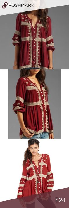 Cute Embroidered FP Blouse Super cute top from Free People that is just perfect for fall! Is in a burgundy red with cream detailing across the top and a tie at the neckline. Super cute and has no flaws that effect wear but I washed it and the red bled into the cream tinting it a bit red and unraveling the tie at the neckline just slightly. I don't think it really changes the look but price reflects this Free People Tops Blouses