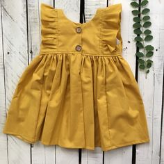 Joy Marie Mustard Dress Mustard is the color for fall. This dress is so perfect for a transition piece. Can be a big sister match for the bubble. Baby Girl Dress Patterns, Baby Dress Design, Frock Patterns, Baby Dress Tutorials, Kids Frocks, Frocks For Girls, Little Girl Dresses, Kid Dresses, Baby Frocks Designs