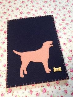 Felt Kindle Fire HD Tablet Cover / Sleeve  Handmade and hand stitched Kindle Fire HD sleeve/cover * The front of the sleeve is navy 100% wool felt. The inner layer is pale beige and reverse is pale grapefruit. The labrador applique is in grapefruit and there is button bone to complete the look! Dimensions: Length approx. 21cm Width approx. 15cm  ** This sleeve will also fit Kindle, Google Nexus 7 and other tablets of similar size Great gift for dog and animal lovers that will also protect…