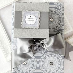 If you're tired of the same old Christmas wrapping paper, try the look of one of these packages for under your Christmas tree this holiday season! http://www.bhg.com/christmas/gift-wrapping/pretty-gift-wraps-and-bows/?socsrc=bhgpin122314elegantsilverpackages&page=3