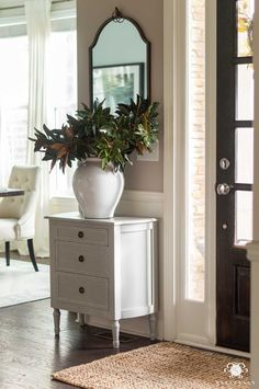 Easy Christmas Decor Ideas for the Entry including an entryway table, large white vase with faux greenery, and a jute rug! Large White Vase, White Vases, Tufted Leather Ottoman, Green Glass Bottles, Christmas Home, Christmas Ideas, Holiday Ideas, Room Rugs, Vases Decor