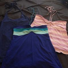 Halter Trio Trio of halter tops. All worn only once. Purple is American Eagle. Blue tops are Arizona and Union Bay. Tops Tank Tops