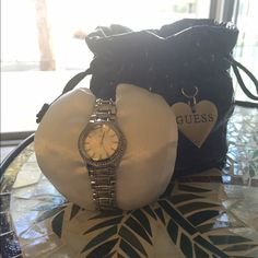 Guess Women's Silver Watch Guess women's opal dial face watch with silver bracelet. Guess Accessories Watches