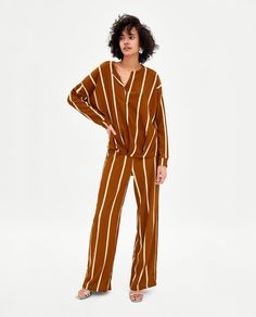 Image 1 of TEXTURED TROUSERS WITH STRIPES from Zara