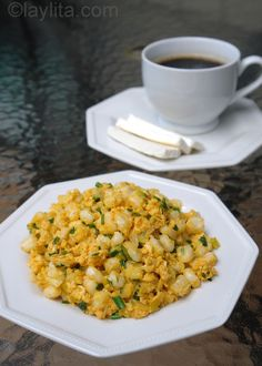 Mote pillo (hominy egg scramble) with queso fresco and coffee