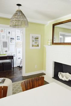 Unusual paint color but I love the the vibrance.  also love the wall of white frames  - from Young House Love