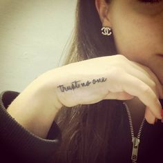 《Trust no one》tattoo on the hand.