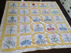 Vintage Handmade Quilt, Yellow with Multi Colored Flowers, White Backing, Blanket/Throw by eddysmercantile on Etsy