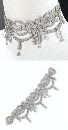 DIAMOND CHOKER-NECKLACE, CIRCA 1910. The articulated band designed as a series of bows alternating with floral sprays within ribbon borders, supporting floral and foliate garlands and fringes, the whole set with numerous old European-cut, single-cut and rose-cut diamonds, mounted in platinum, length 13½ inches, segment at back (not illustrated) detaches. by bleu.