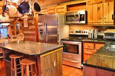 Kitchen Makeover Open to the living and dining areas, the kitchen is equipped with new granite countertops, stainless appliances and a center work island with bar seating. STONEBRIDGE LOG HOME W/ END OF ROAD PRIVACY Kitchen Countertop Materials, Kitchen Countertops, Kitchen Cabinets, Kitchen Backslash, Kitchen Sinks, Blue Countertops, Laminate Countertops, Dark Cabinets, Laminate Flooring