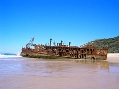perhaps its their tragic beauty. This is a shipwreck on Fraser Island, Australia. It wrecked on the coast on its last voyage (towed for scrap metal) to Tokyo from Melbourne. South Pacific, Pacific Coast, East Coast, Fraser Island Australia, Coast Australia, Ghost Ship, Shipwreck, Beautiful Beaches, Places Ive Been
