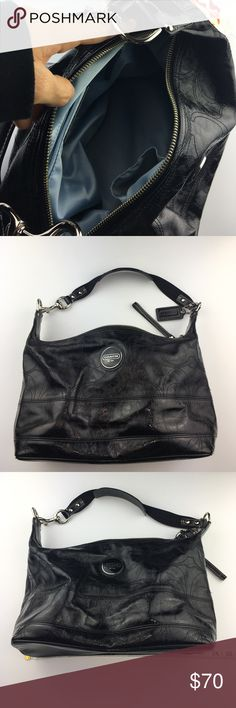 "Coach black handbag. Authentic patent leather coach brand purse. It has the coach logo (letter C) embossed throughout the bag. Doesn't have high gloss shine. Larger logo is 1""&1/2. Has coach dog tag attached to strap hardware. All hardware silver & not tarnished. Main part of strap is thick cloth material along w/ leather & silver hardware at the ends. Interior is light baby blue. 1 large interior pocket with zipper. 2interior smaller pockets. No stains or tears. Hits at waist when worn…"