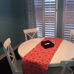 Coral table runner in my aqua blue dining room.