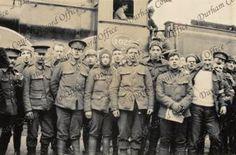 Soldiers of the 6th Battalion The Durham Light Infantry standing beside a railway engine, en route to France, taken by PHB Lyon, April 1915 (D/DLI 7/424/2(28))