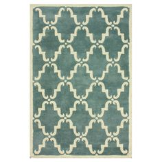 Stylishly anchor your living room seating group or dining ensemble with this hand-woven wool rug, showcasing a trellis motif and light blue hue.