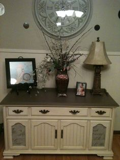 This was a old vintage stereo my husband had. I wanted a buffet to go with my dining table so I decided to use the stereo and it works great. I used 2 sample paints from Lowe's for 3 dollars a piece and a 5 dollar Martha Stewart glaze.I used left over fabric from my dining room chairs to cover up the old fabric that was over the speakers.