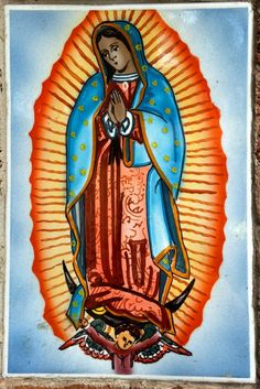 The Virgin of Guadalupe (Virgen de Guadalupe) tile art in Coyoacán, Mexico City. The Ciudad de México is full of religious imagery like this due to the highly Catholic population and it really is beautiful!
