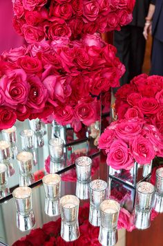 An assortment of red roses in varying shades and staggering heights create intirgue.
