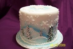 Snow themed three tiered holiday cake.