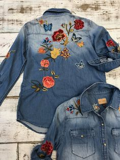 100% floral and butterfly denim embroidered shirt. snap and small distressing on shirt. Style: H3874A Name: Olivia Wash: Delano