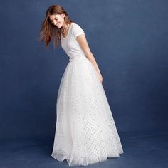 Some modern bridal parties opt to go the nontraditional route by wearing white bridesmaid dresses. This floor-length tulle bridesmaid skirt with subtle polka dots is perfect for rocking this trend.