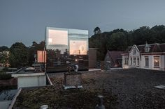 with facades of mirrored glass, the rooftop extension features a single bedroom for a 12 year old boy in a structure that disappears into the sky.