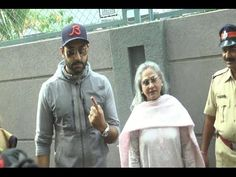 Abhishek Bachchan with Jaya Bachchan cast their votes for Maharashtra Assembly Elections 2014.