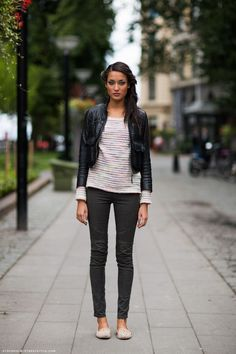 Grey skinny, stripped shirt and leather coat.