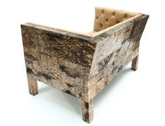 Covered in birch bark, the surprising furniture collection from Netherlands-based furniture designer Werner Neumann has everything it needs to be successful – form, material, function and design. Upholstered leather seating and geometric wood drawers meet in this ostentatious collection of furniture pieces