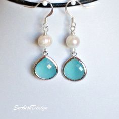 Lovely hand made drop earrings are made with a high quality wire wrapped fresh water pearl and Silver Framed Mint Glass Stone Pendants hanging from sterling silver ear wire.